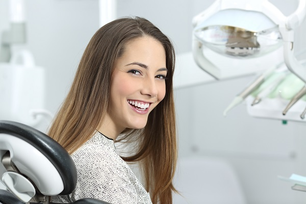 Woman sitting in dentist chair