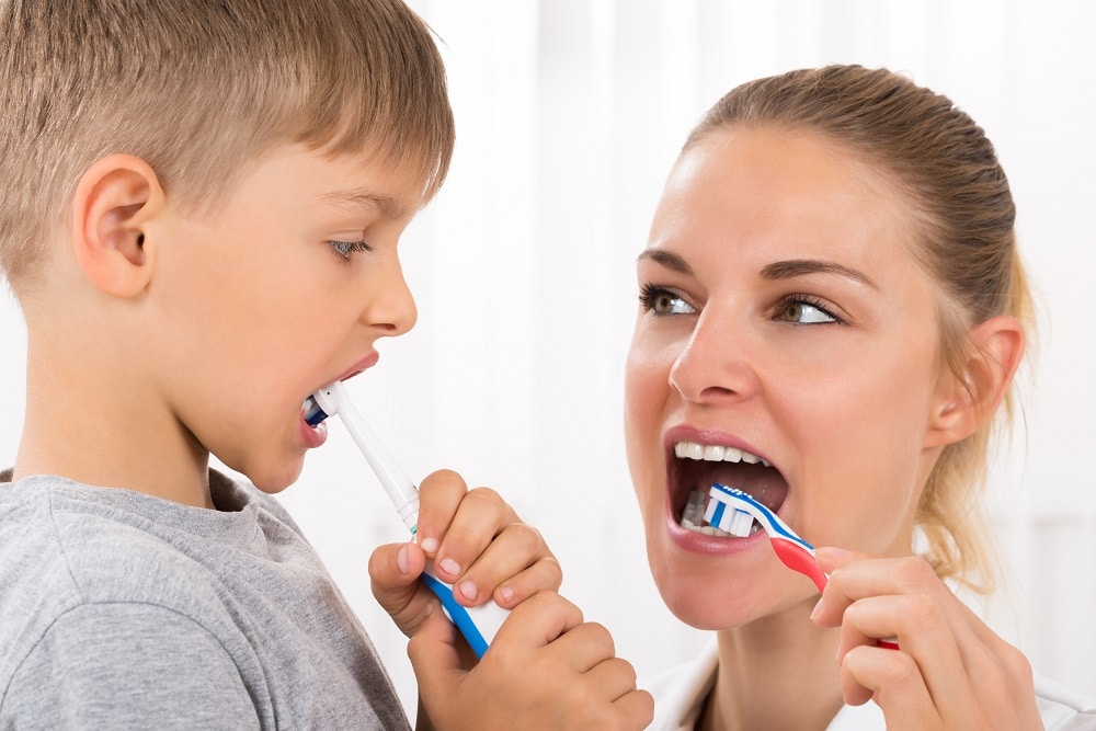 Using a toothbrush with mum