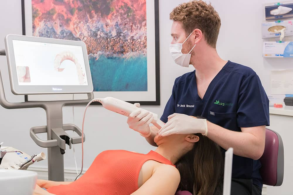 dentist viewing results with patient